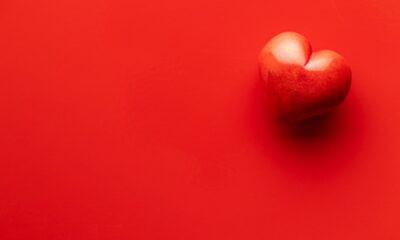 red-heart-on-red-background