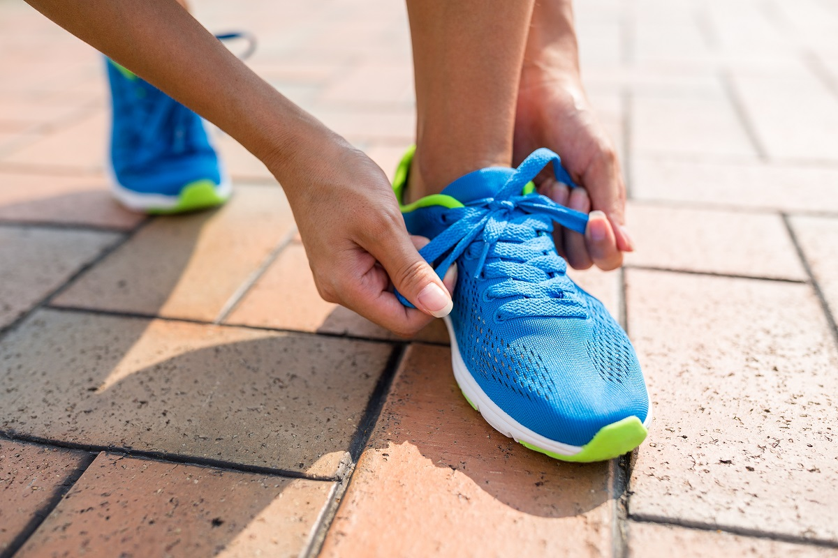 woman-fixing-the-shoelace