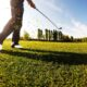 golfer-performs-a-golf-shot-from-the-fairway
