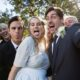 happy-couple-posing-with-guests-during-wedding