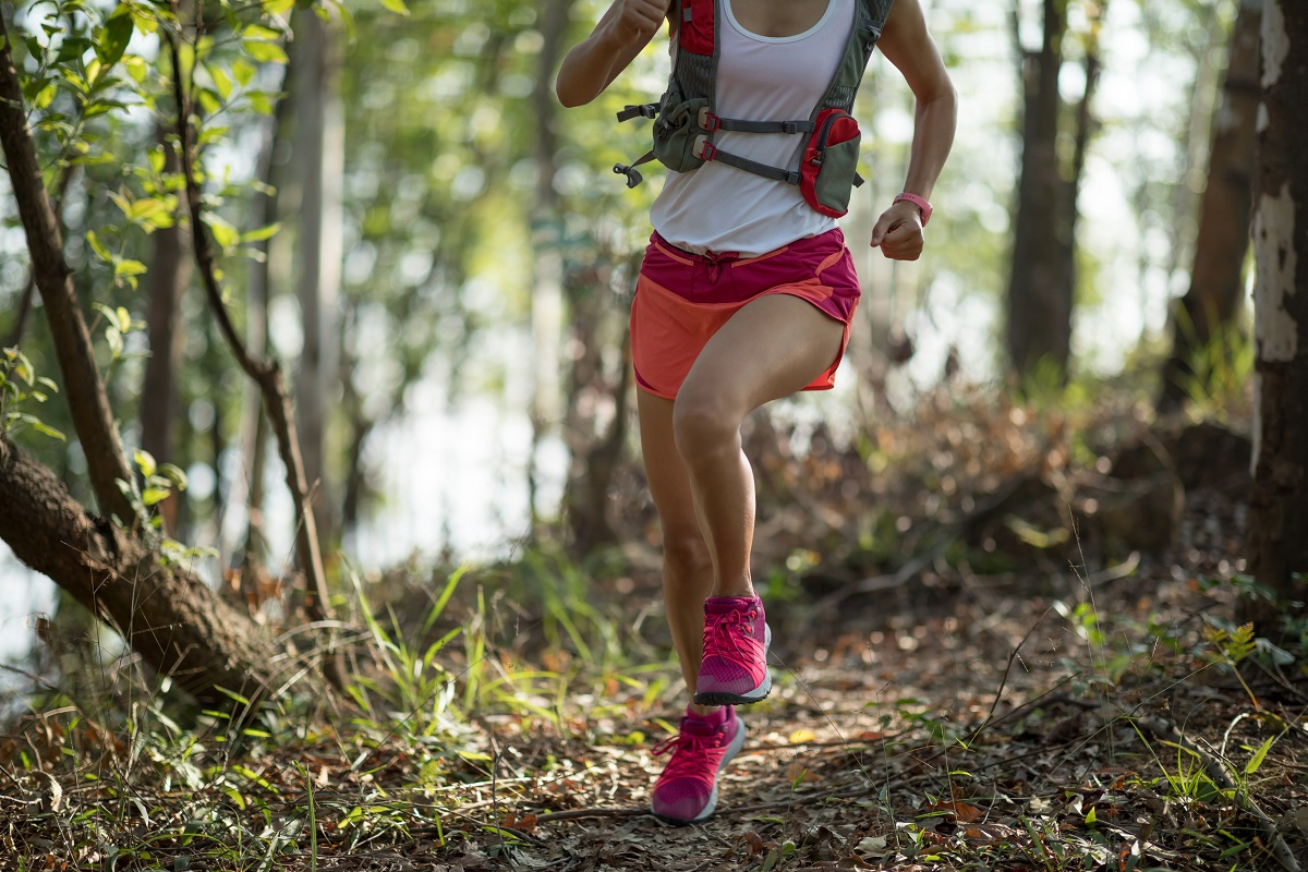 sportswoman-cross-country-trail-running-in-forest